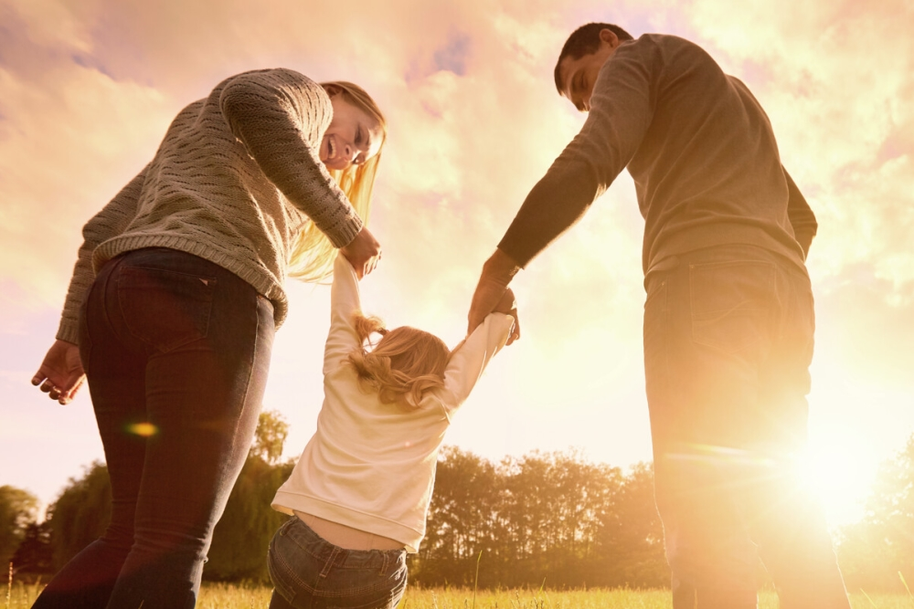 Family holding hands outdoors